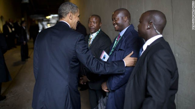 President Obama greets security personnel from South Africa.