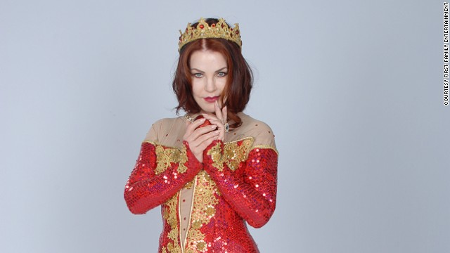 "Priscilla Presley makes her pantomime debut at the New Wimbledon theater, London. (2012). She returns to the pantomime stage this year to play the Wicked Queen in ""Snow White and the Seven Dwarfs"" opposite ""Willow"" actor Warwick Davis."