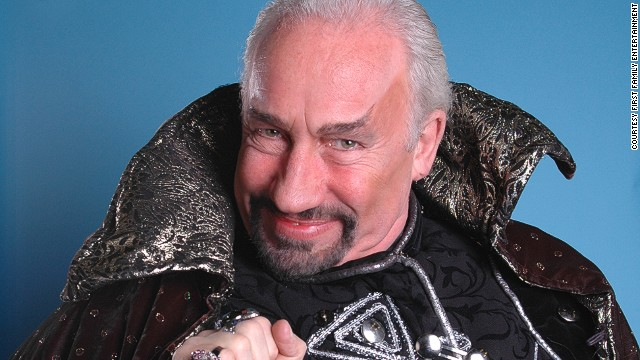 "Simon Callow (most often seen performing Shakespeare but perhaps best remembered worldwide for his roles in ""Four Weddings and a Funeral,"" ""A Room with a View"" and ""Shakespeare in Love"") as Abanazar in ""Aladdin"" at the Richmond Theatre, Surrey (2005)."