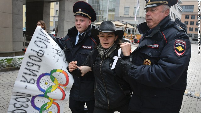 Police officers detain a gay rights activist during an unauthorized protest outside Sochi 2014 headquarters in September.