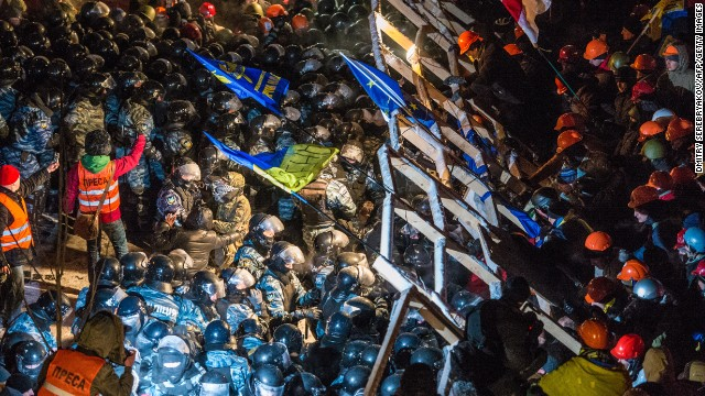 Riot police storm barricades set up by pro-European Union protesters in Independence Square in Kiev, on Wednesday, December 11.