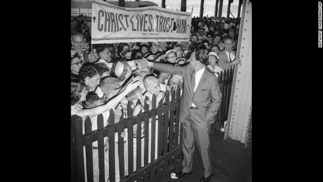 Supporters greet Graham upon his arrival in New York on June 30, 1959. Graham and his wife were returning from a six-month speaking tour, which included stops in Australia and Russia.