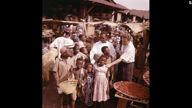 Graham visits with children during a trip to a village in Ghana in January 1960.