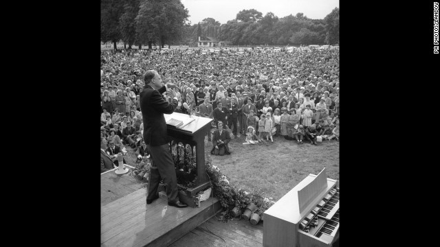 Graham preaches to a crowd of thousands at an open-air rally in Victoria Park as part of his Greater London Crusade on June 26, 1966.