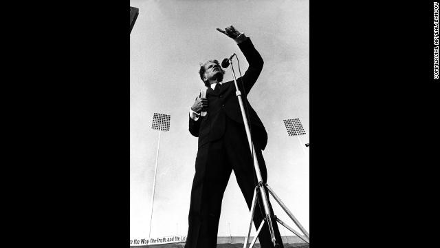 Graham speaks at Liberty Bowl Memorial Stadium in Memphis, Tennessee, on May 8, 1978. Inclement weather had forced the crusade to the nearby Mid-South Coliseum, but when the clouds lifted, Graham went to the stadium to speak to those who could not get into the smaller indoor arena.