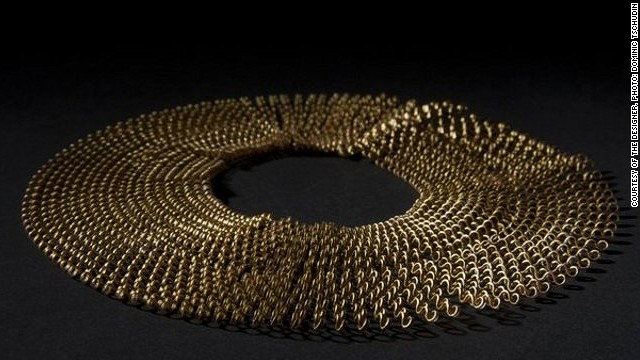 French designer Florie Salnot's recycled plastic necklace, titled <i>Plastic Gold, </i>is a product of her work with women from western Sahara. Inspired by the traditional jewelery worn by these women, Salnot has devised a craft they can practice despite their limited resources.<i> </i>