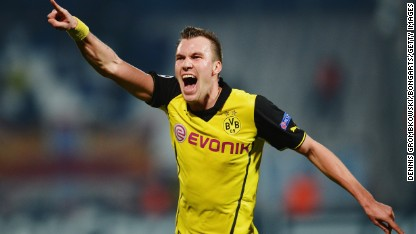 Football: Borussia Dortmund into last 16