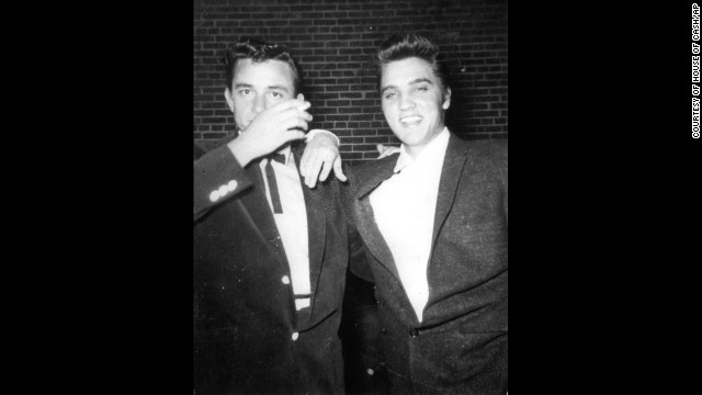 Cash, left, and Elvis Presley pose together in the 1950s.