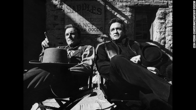 "Kirk Douglas, left, and Cash film an episode of ""The Johnny Cash Show"" in Arizona on January 13, 1971."