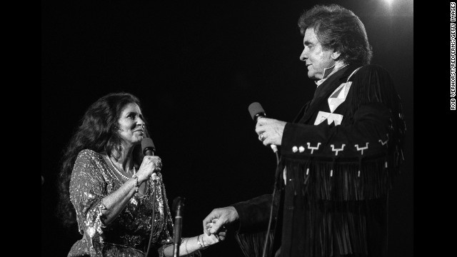June Carter Cash and Johnny Cash perform on September 3, 1987.