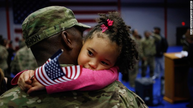 Army Spc. Michael Fashion holds his daughter Malia, 5, upon his return home last month after a deployment in Afghanistan.<br />