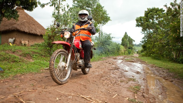 Misheck Mafemera, a health care worker, uses his motorcycle to see people in villages in the Seke district of Zimbabwe.