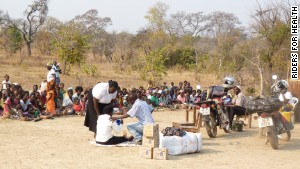 A group of health workers in Mantanyani village, Southern Province, in Zambia, provide a health education lesson to local people about the importance of using water treatment kits.