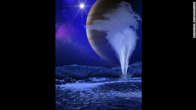 An artist depicts water vapor spewing up from underneath the surface of Europa, a moon circling the planet Jupiter. It could mean that life could be supported inside the moon.