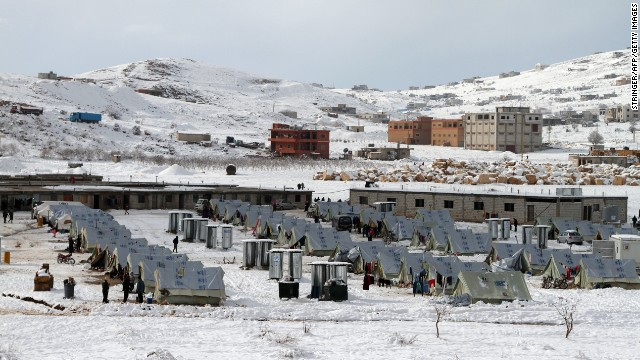 A general view of a refugee camp in the town of Arsal in the Lebanese Bekaa valley on Friday, December 13. Thousands of Syrian refugees living in makeshift camps in Lebanon were hit with a winter storm that brought snow, rain and freezing temperatures to the country.