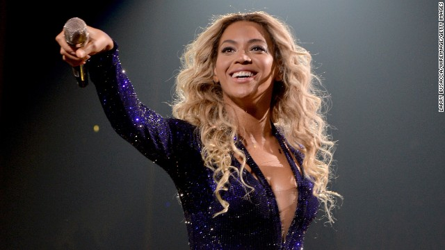 "Beyoncé performs on stage during ""The Mrs. Carter Show World Tour"" at Staples Center on December 3, in Los Angeles. Her new music video ""Partition"" is stirring controversy. Here is a look back at her life and career:"