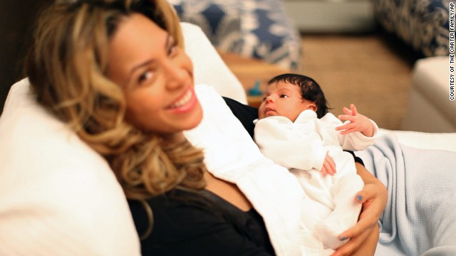 "In this undated image released by Beyonce.com, Beyonce Knowles holds her daughter Blue Ivy in a recent family photo. A hand-written note accompanying the photos reads, ""We welcome you to share our joy."""