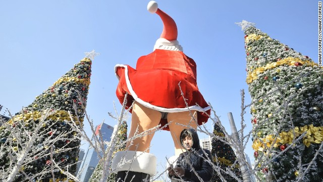 "A rear view of ""Santa Monroe."" In China, Santa Claus is referred to as ""Dun Che Lao Ren,"" which means ""Christmas Old Man."""