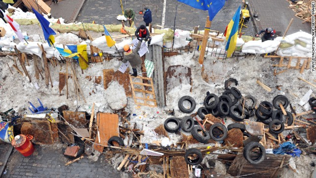 Protesters stand at a barricade in Kiev on December 13.