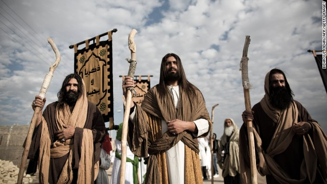 "An Iranian Muslim Shiite man, acting as Jesus, center, takes part in the annual religious performance of ""Taazieh"" in the Iranian town of Noosh Abad on November 12, 2013. It marks the mourning period of Ashura, which commemorates the killing of the Prophet Mohammed's grandson Imam Hussein."