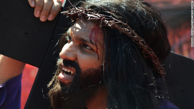 Indian Christian Alan D'Souza portrays Jesus as he carries a cross through a residential area on Good Friday in Mumbai on March 29. A procession of Indian Christians from all walks of life participated in the march portraying the suffering meted out by Roman soldiers to Jesus on his way to be crucified.