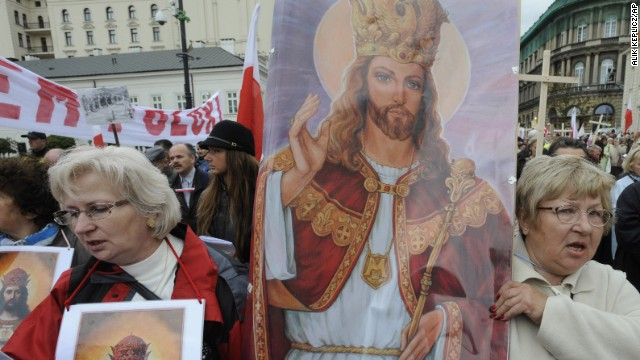 Women carry a religious painting as hundreds of conservative Roman Catholics march through Warsaw's downtown demanding more religion in social and political life in Poland on September 19, 2010.
