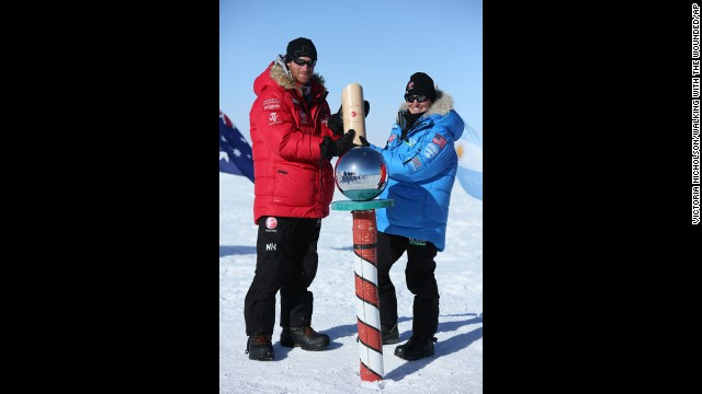 Prince Harry, left, and Margaux Mange of Team U.S. pose at the South Pole after more than three weeks pulling sleds across the frozen wastes of Antarctica. The group stood at the bottom of the world at midday.