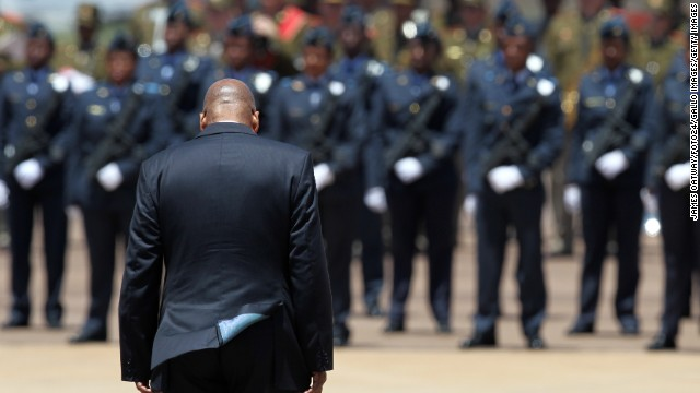 President Jacob Zuma awaits the cortege of Mandela at the Waterkloof air base in Pretoria.