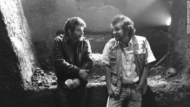 "Executive producer George Lucas, left, and Spielberg confer on the set of the film ""Indiana Jones and the Last Crusade"" in 1989. The two influential filmmakers have worked on multiple movies together."