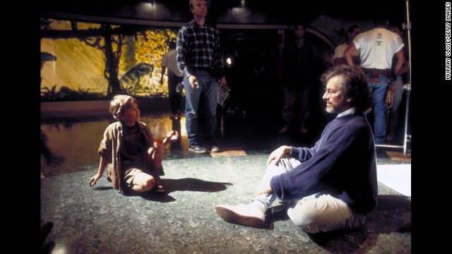 "Spielberg sits with child actor Joseph Mazzello during the filming of ""Jurassic Park"" in 1993. The film, based on the science-fiction novel by Michael Crichton, is Spielberg's highest-grossing movie to date. It has made more than $914 million."