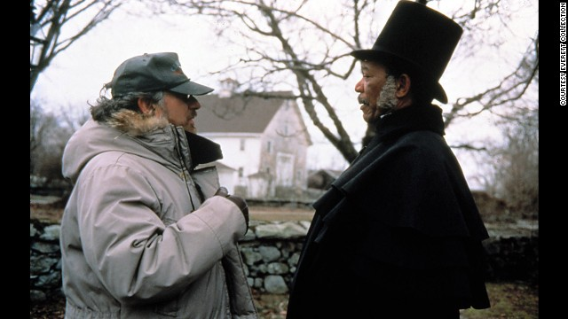 """Spielberg appears on the set of the 1997 film """"Amistad"""" with actor Morgan Freeman."""