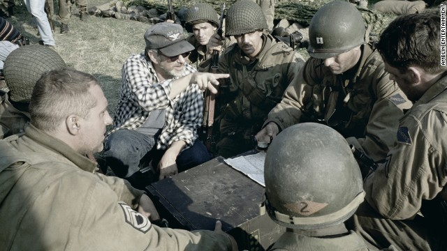 """Spielberg directs actors Tom Hanks, Jeremy Davies, Tom Sizemore, Adam Goldberg and others in the war drama """"Saving Private Ryan"""" in 1998. Spielberg won his second Best Director Oscar for the film, and he also received the U.S. Navy's highest civilian award, the Distinguished Public Service Award."""