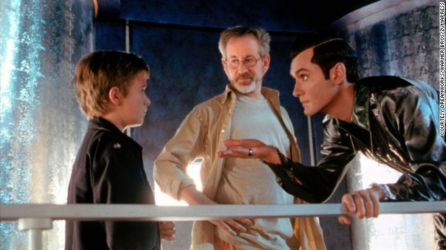 """Actor Haley Joel Osment, left, Spielberg and Jude Law work on a scene from the movie """"A.I. Artificial Intelligence"""" in 2001. The film is about a highly advanced robotic boy longing to become """"real,"""" a real sci-fi """"Pinocchio"""" drama."""
