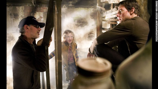 """Spielberg, left, with Cruise and Dakota Fanning on the set of """"War of the Worlds"""" in 2005. The movie recreated the legendary science-fiction novel by H.G. Wells."""