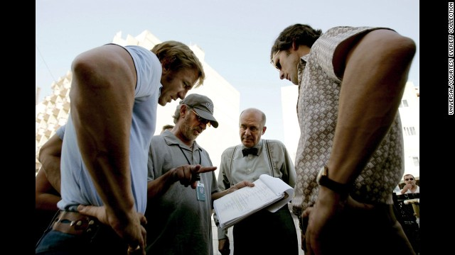 "Spielberg, second from left, talks with actors Daniel Craig, Hanns Zischler and Eric Bana on the set of ""Munich"" in 2005. The movie is based on the hostage crisis that took place during the 1972 Munich Olympics."