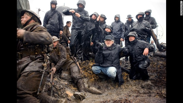 """Spielberg sets up a shot on the set of the 2011 film """"War Horse,"""" an epic adventure set against a sweeping canvas of rural England and Europe during World War I."""