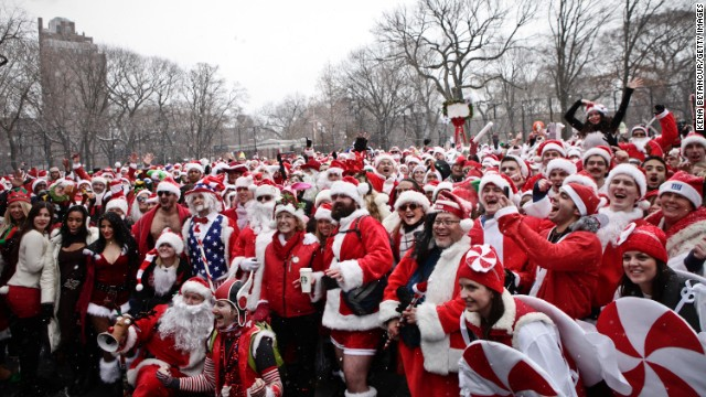 Revelers dressed as Santa Claus pose for a picture at Tompkins Square Park during the annual NYC Santacon on Saturday, December 14.
