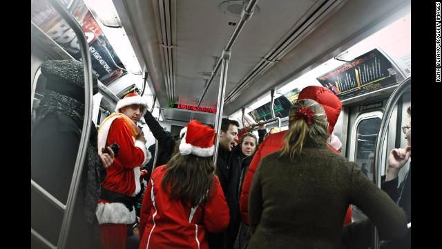 Santas invade the subway.
