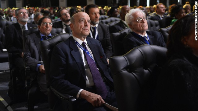 Former French Prime Ministers Alain Juppe, center, and Lionel Jospin, right, attend the funeral ceremony.