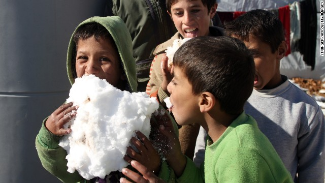 Syrian children play with snow in the Arsal refugee camp on December 15.