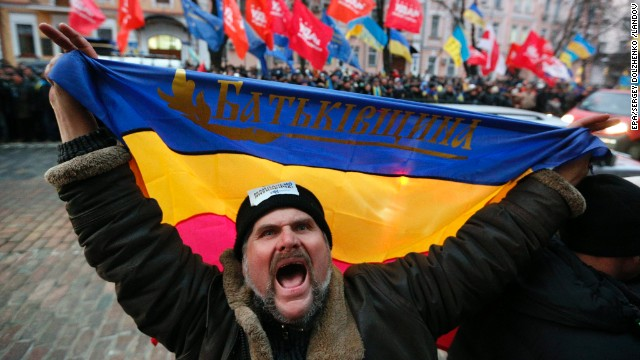 A protester shouts slogans and waves a flag of the Batkivshchyna party during a protest near the Ukrainian Security Service building in Kiev on December 15.