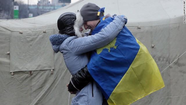 A couple of pro-EU activists share a tender moment at a tent camp in Kiev on December 15.