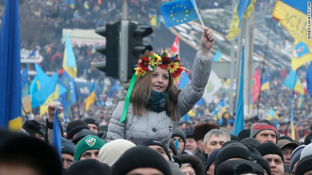 Pro-EU activists, one waving the EU flag, gather during a rally in Kiev on December 15.