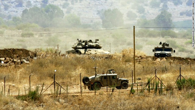 A picture taken from a Lebanese village in August shows Israeli troops on the border between Lebanon and Israel.