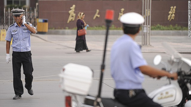 Chinese policemen on patrol in this file photo taken in Kashgar, a city in China's volatile western region of Xinjiang.