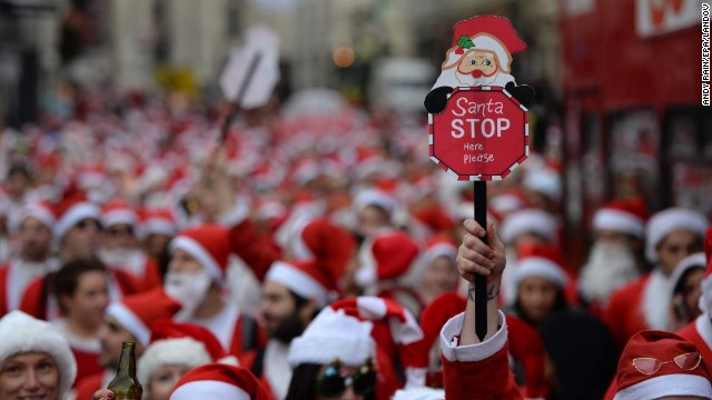 Hundreds of people dressed in Santa Claus costumes march through central London during the annual SantaCon celebration on December 14.