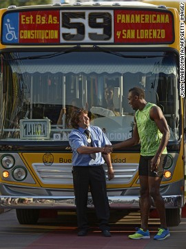 Bolt, who holds the world 100m record with a time of 9.58 seconds, completed the 80m race ahead of the public bus that was packed with passengers and afterward shook hands with the driver.
