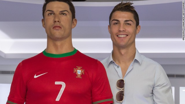 Cristiano Ronaldo stands next to a wax figure of himself at the opening of a museum dedicated to his football career in his Portuguese hometown.