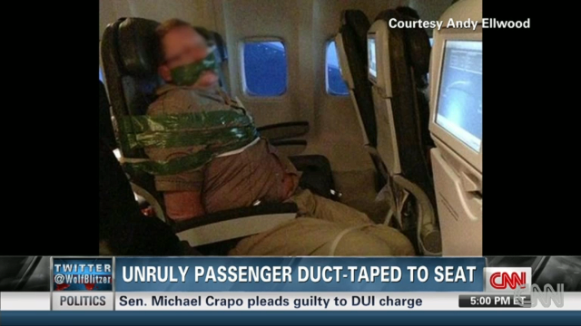 "A photo of man a bound to his seat on an Iceland Air flight made social media rounds. The man, apparently inebriated, was ""hitting, screaming and spitting at other passengers,"" said the airline, adding that duct tape and plastic zip ties are standard protocol when restraining unruly passengers."