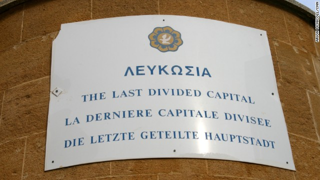 "In the center of the old town, a matter-of-fact sign on the wall near the Ledra Street crossing declares that you are standing in ""the last divided capital"" in the world."